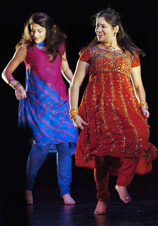 Shavya Samala, 16, (right) and Leila Musavi, 15, perform an Indian dance during the University of Maine's sixth annual International Dance Festival on Saturday, Feb. 20, 2010 at the Collins Center in Orono. The event featured about 100 dancers representing dozens of countries and cultures from around the world. BANGOR DAILY NEWS PHOTO BY BRIDGET BROWN