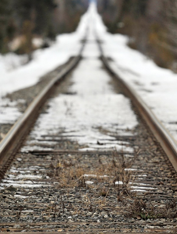 In this photo made Feb. 19, 2010, the track for the Montreal, Maine & Atlantic Railway is seen from the crossing at Route 159 in Crystal, Maine. The railway has filed notice with the federal Surface Transportation Board that it intends to abandon 233 miles of track that stretch from Madawaska to Millinocket. (AP Photo/Michael C. York)