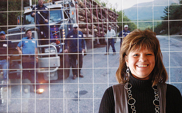 Judy Pelletier, wife of Eldon Pelletier and one of the stars of ?American Loggers,? stands in front of a tile photograph of a Pelletier logging truck at Pelletier Loggers Family Restaurant Bar and Grill on Saturday. The Millinocket restaurant will open early next month. BANGOR DAILY NEWS PHOTO BY NICK SAMBIDES JR.