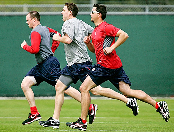 Boston Red Sox pitchers Jon Lester, left, John Lackey, center, and Josh Beckett run during conditioning drills during baseball spring training in Fort Myers, Fla., Friday, Feb. 19, 2010. (AP Photo/Nati Harnik)