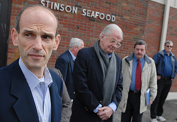 Joined by local leaders, state officials and cannery personnel,  Gov. John Baldacci, far left,  talks with the media during his visit to the former Stinson Cannery Tuesday, February 23, 2010. Standing nearby is Thaxter Trafton, state Commisioner of Economic and Community Development.  Gov. Baldacci met with employees and local officials to discuss the announced closure of the Stinson Seafood sardine cannery in the village of Prospect Harbor. About 130 employees are expected to lose their jobs when the facility closes for good on April 18. BANGOR DAILY NEWS PHOTO BY JOHN CLARKE RUSS