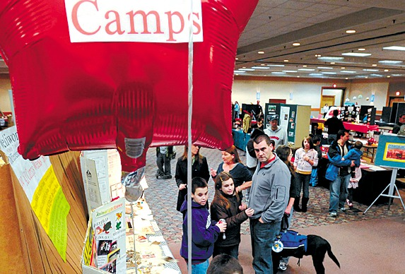 People walk around at the 11th annual Camp Bangor fair at the Bangor Civic Center Tuesday afternoon.  This year about 70 exhibitors offered opportunities to youngsters to choose from over 100 programs. (Bangor Daily News/Gabor Degre)