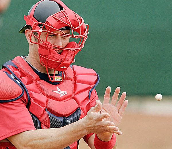 Boston Red Sox catcher Jason Varitek catches a mini-baseball during baseball spring training on the first day of pitchers and catchers workout in Fort Myers, Fla., Saturday, Feb. 20, 2010.(AP Photo/Nati Harnik)