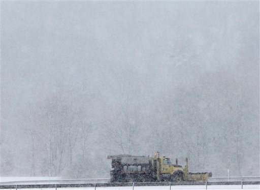 A department of transportation plow clears snow on the New York State Thruway in Canaan, N.Y., on Tuesday, Feb. 23, 2010.  Areas of upstate New York received several inches of snow, and more is expected through Wednesday.  (AP Photo/Mike Groll)