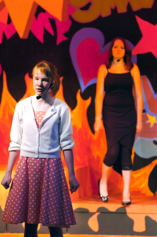 Troy Howard Middle School students Autumn Stupca, 13, (left) and Sarah Berry, 13, rehearse a song from &quotGirl Power,&quot an original musical written by two of the school's teachers, Jason Bannister and Justin Bari. The play opens Friday (Feb. 26) and features more than 35 cast members with Autumn and Sarah playing two of the lead characters. BANGOR DAILY NEWS PHOTO BY BRIDGET BROWN