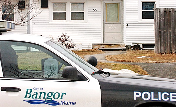 A Bangor Police officer monitors the residence of 55 Bald Mountain Drive where a one-year-old was found dead Tuesday, Feb. 23, 2010 in Bangor. The unattended death is under investigation and an autopsy will be performed today. BANGOR DAILY NEWS PHOTO BY BRIDGET BROWN