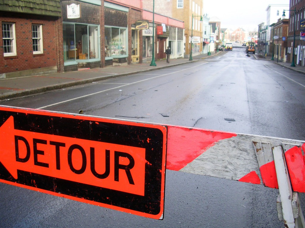 The roof of a Main Street building shut the road down past Limerock Street Friday morning. The roof had blown over the building and into the street. Rockland Public Works had most of the debris cleaned by 9 a.m., Friday, Feb. 26, 2010.  (Bangor Daily News photo by Heather Steeves)