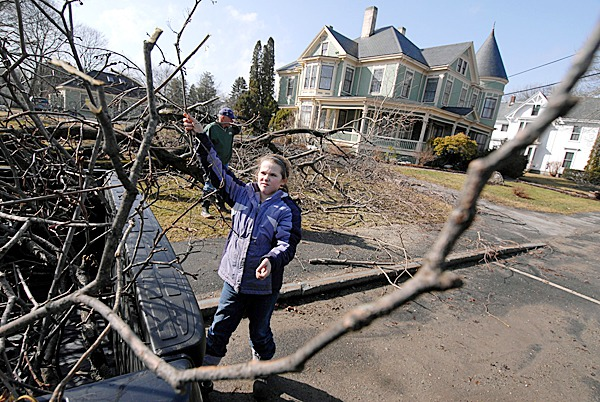 11-year-old Hana Galkowski (cq), helps her grandfather, Larry Galkowski (in background) of Union clean up debris after a section of a silver maple in her family's front yard on Limerock Street in Rockland was toppled by high winds early Friday morning. The downed tree section also downed a utility line to the Limerock Inn next door (in background). The Thursday's rainfall and the overnight storm caused considerable damage across Maine with thousands of homes and businesses left without electricity service.   BANGOR DAILY NEWS PHOTO BY JOHN CLARKE RUSS