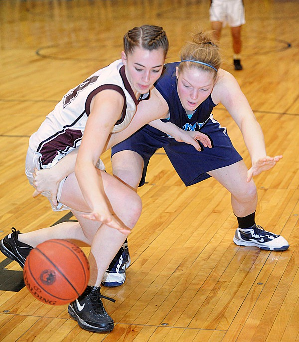Nokomis High School's Marissa Shaw (left) scrambles for the ball with York's  Nicole Taylor during the first half of the class B State final game at the Bangor Auditorium Friday evening.   BANGOR DAILY NEWS PHOTO BY GABOR DEGRE