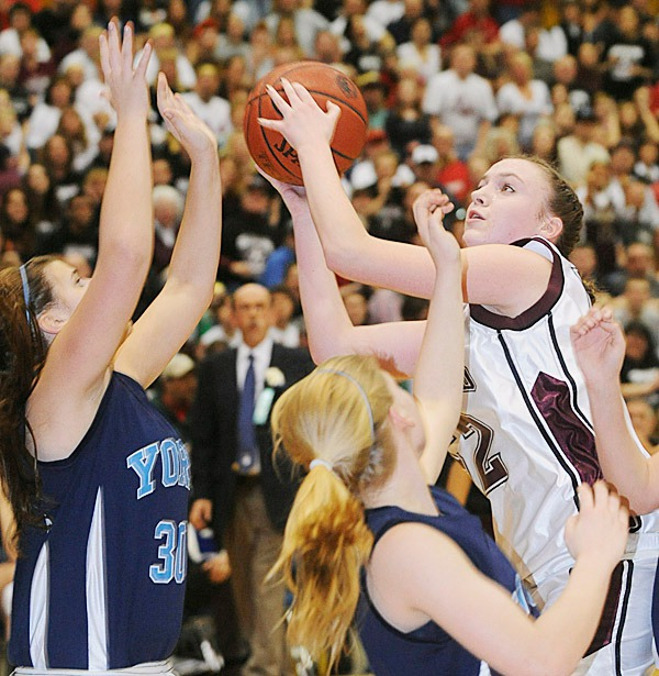 Nokomis High School's Danielle Watson (right) takes a rebound over York's Lindsey Contella (left) and Andrea Mountford during the first half of the class B State final game at the Bangor Auditorium Friday evening.   BANGOR DAILY NEWS PHOTO BY GABOR DEGRE