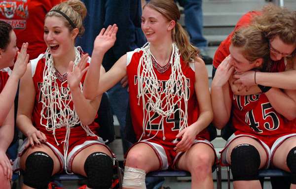 The Fort Fairfield Tigers including (from left) Danielle Tracy, Kelsie Wilson, Courtney Churchill and Amanda Hotham celebrate their 67-59 win over Greenville for the Girls Class D basketball championship Saturday, Feb. 27, 2010 at the Augusta Civic Center. Buy Photo