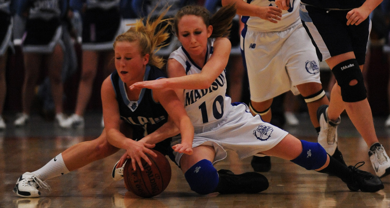 Calais's Alexandria McVicar and Madison's Krista Grant scramble for a loose ball during 2nd period action on Saturday, Feb. 27, 2010 during the class C state championship game at the Augusta Civic Center.