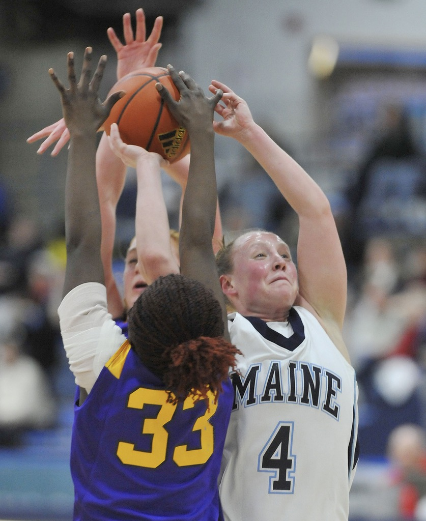 Albany's Tabitha Makopondo, (33), strips the ball from Maine's Kristin Baker,(4), in the first half of their game in Orono, Maine, Saturday, Feb. 27, 2010.