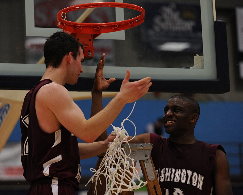 Washington Academy's Ben Teer, left, and Noah Von Rotz congratulate each other after defeating Dirigo for the class C state basketball title on Saturday, Feb. 27, 2010 the Augusta Civic Center. WA won 58-70.
