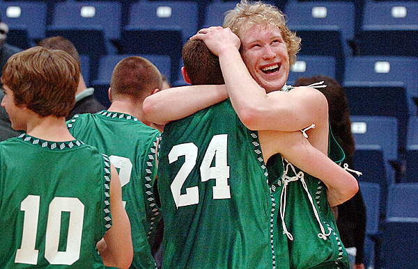 Schenck senior Cody LeVasseur (right) is all smiles as he hugs Brandon Theriault (24) following their win over Richmond for the boys Class D championship at the Augusta Civic Center on Saturday, Feb. 27, 2010. Schenck won 65-43. BANGOR DAILY NEWS PHOTO BY BRIDGET BROWN