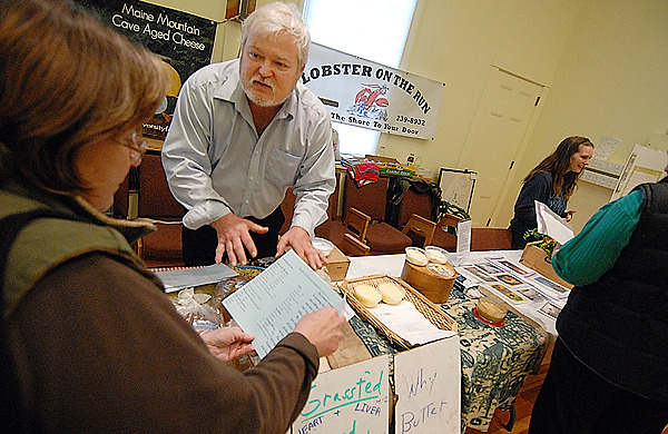 Representing himself and five other local farmers, Bob Perol of Diversity Farm in Troy, Maine answeres questions from Susan Wishkoski (cq),left, of Bangor during the food food fair at Congregation Beth El in Bangor Sunday afternoon, February 28, 2010. The Maine Council of Churches and the Maine Organic Farmers and Gardeners Association continue to sponsor fairs like these where people can learn and contribute to community sustainable agriculture.  BANGOR DAILY NEWS PHOTO BY JOHN CLARKE RUSS