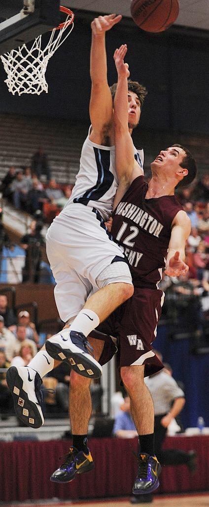Washington Academy's Ben Teer is fouled by Dirigo's Tyler Chiasson while shooting on Saturday, Feb. 27, 2010 during the class C state championship at the Augusta Civic Center. BANGOR DAILY NEWS PHOTO BY KEVIN BENNETT