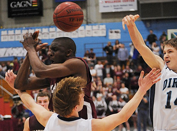 Washingotn Academy's Noah Von Rotz has the ball slapped away by Dirigo's Cody St. Germain, right, as Von Ritz slams into Dirigo's Tyler Gates, foreground, on Saturday, Feb. 27, 2010 during the class C state championship at the Augusta Civic Center. BANGOR DAILY NEWS PHOTO BY KEVIN BENNETT