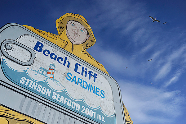 The Beach Cliff Sardine fisherman sign towers over the former Stinson Seafood Plant in Prospect Harbor Thursday  February 18, 2010. Bumble Bee Foods, the current plant owner notified employees Wednesday, February 17 that the plant will close in April after being a fixture there for over 100 years . BANGOR DAILY NEWS FILE PHOTO BY JOHN CLARKE RUSS