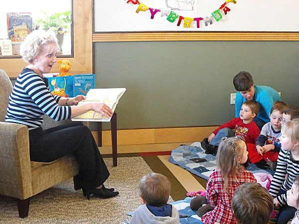 Carmel Bowers, left, reads &quotOh, The Places You'll Go&quot by Dr. Seuss to head start students in Houlton Tuesday afternoon.Tthe University of Maine at Presque Isle, the Houlton-Hodgdon SAD 29 and SAD 70 Adult Education program and Northern Maine Community College held their own &quot&quotHappy Birthday, Dr. Seuss!&quot event for area preschoolers, elementary-age students and community members. The event also marked Read Across America Day, which encouraged youth to read on a daily basis. BANGOR DAILY NEWS PHOTO BY JEN LYNDS
