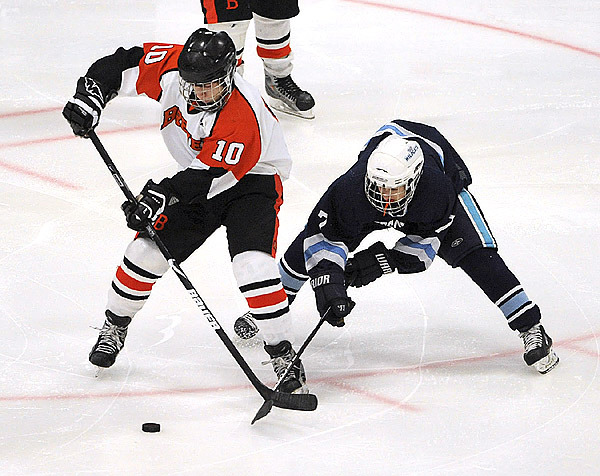 Brewer's Brody Valley (left) and Presque Isle's Connon Shaw battle for the puck during the second period of the Eastern Maine Class B final game at the Alfond Arena in Orono Tuesday evening.