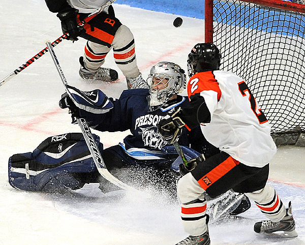Presque Isle's goalie Josh MacFarline (left) deflects a shot by Brewer's Jamie Williamson (2) during the first period of the Eastern Maine Class B final game at the Alfond Arena in Orono Tuesday evening.