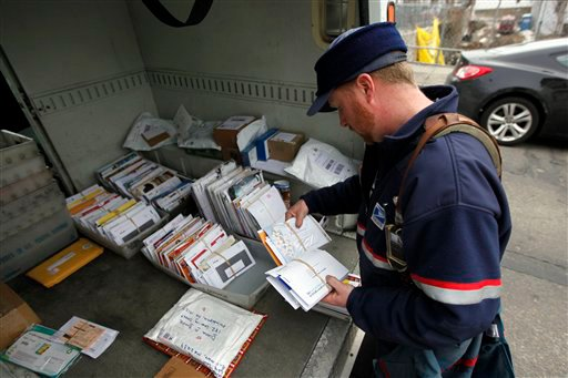 Letter carrier Kevin Pownall gathers mail from the back of his truck in Philadelphia, Tuesday, March 2, 2010. The U.S. Postal Service is increasing the pressure for dropping Saturday home delivery as it seeks to fend off massive financial losses. (AP Photo/Matt Rourke)