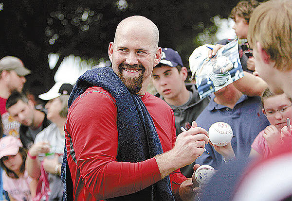 Boston Red Sox first baseman Kevin Youkilis interacts with fans at baseball spring training on the first day of pitchers and catchers workout, in Fort Myers, Fla., Saturday, Feb. 20, 2010.(AP Photo/Nati Harnik)