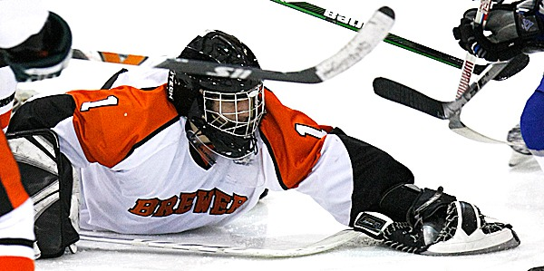 PHOTO: JASON P. SMITH..... Brewer High School's Eric White makes a save during the game against Lawrence High School at the Class B Eastern Maine high school semifinal, held at the Sukee Arena in Winslow, Maine on Saturday, February 27, 2010. Brewer won the game 10-2.   ****Note to editor*****: Please include my middle initial &quotP&quot in my byline.