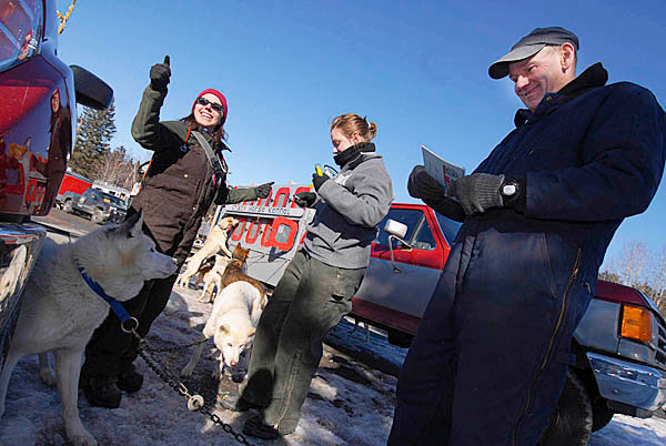 Veterinarian Karen Stasiak, left, of Kremmling, Colorado gives the thumbs up after checking &quotGranger&quot (left), &quot Strider&quot and other Siberian huskies belonging to owner/musher Terry Knowles, right, of Brownville, Maine during the the veterinary examinations for the dogs at Lonesome Pines Trails in Fort Kent Friday, March 5, 2010. Assisting them was vet tech Heather McEwen, center, of Bedford, NH. Knowles is competing in Saturday's Can-Am Crown 30-mile sled dog race. Knowles, 62, has been mushing for 25 years. He is a veteran of the 60-mile Can-Am race and this is his second year racing in the Can-Am 30.   BANGOR DAILY NEWS PHOTO BY JOHN CLARKE RUSS