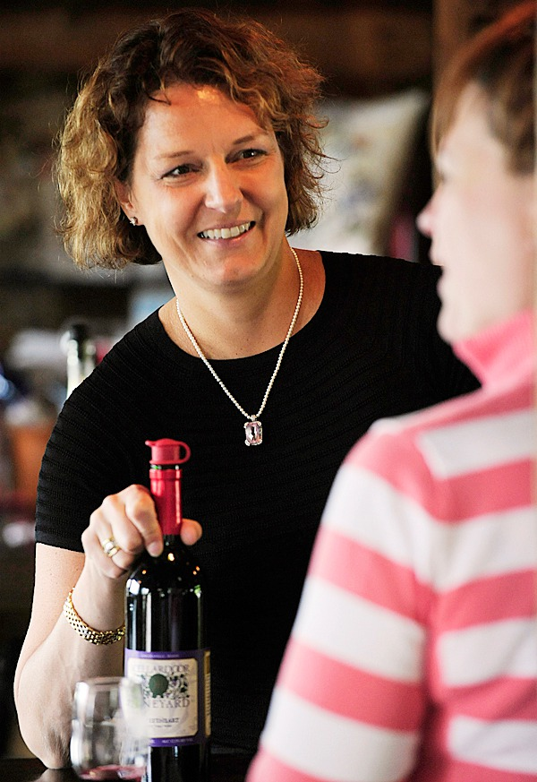 Cellardoor Vineyard owner Bettina Doulton gets feedback about Sweetheart, one of the vineyard's dessert wines, from a visitor Olga Violett of Morris Plains, N.J., during a wine and cheese tasting at the Lincolnville location Sunday.  BANGOR DAILY NEWS PHOTO BY JOHN CLARKE RUSS