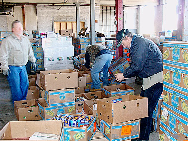 Boxes of donated food from the Cahill Food Bank of Florida that were unloaded from a tractor-trailer truck in Dover-Foxcroft Friday morning were being sorted by volunteers from local churches later that day. The food will be processed through the Living Word Ecumenical Food Cupboard BANGOR DAILY NEWS PHOTO BY DIANA BOWLEY