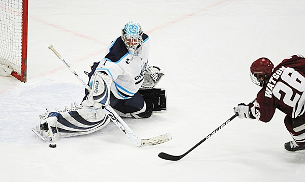 The University of Maine's goalie Shawn Shirman makes a save on a shot by Brett Watson of the University of Massachusets during the first period of the game at the Alfond arena in Orono Friday.  BANGOR DAILY NEWS PHOTO BY GABOR DEGRE