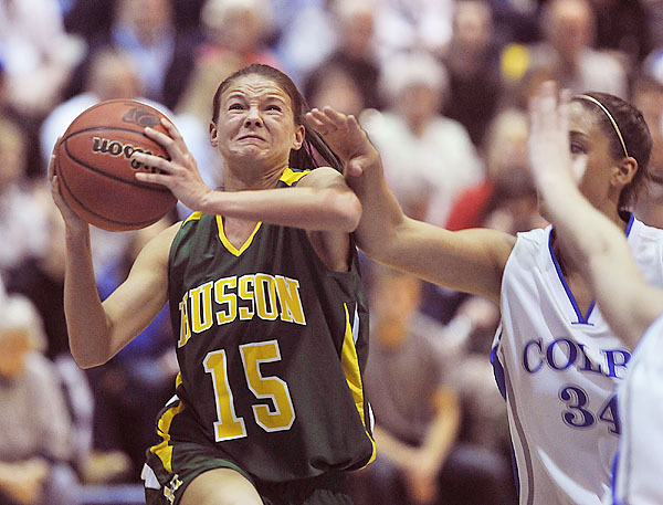 HUsson's Brianna Hanscom, (15), draws the foul as she drives past Colby's Jil Vaughan, (34), in the first half of their playoff game at Colby College, March 5, 2010.