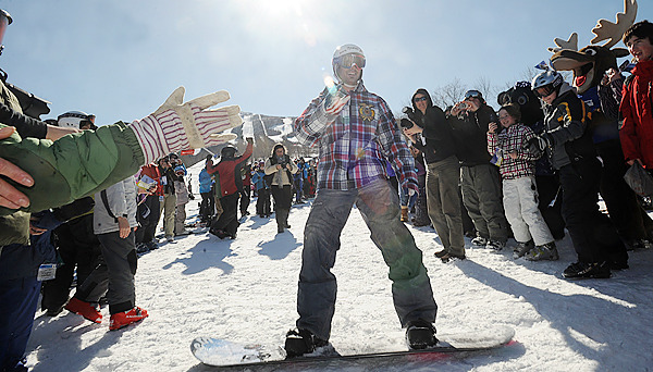 Two time Olympic gold medalist Seth Wescott is awaited by a crowd of people gathered to see him as he arrived to his homecoming celebration on a snowboard. Wescott's won the gold medal in snowboard cross at the 2010 Vancouver Winter Olympic Games. The event was held at the Sugarloaf ski resort Saturday. (Bangor Daily News/Gabor Degre)
