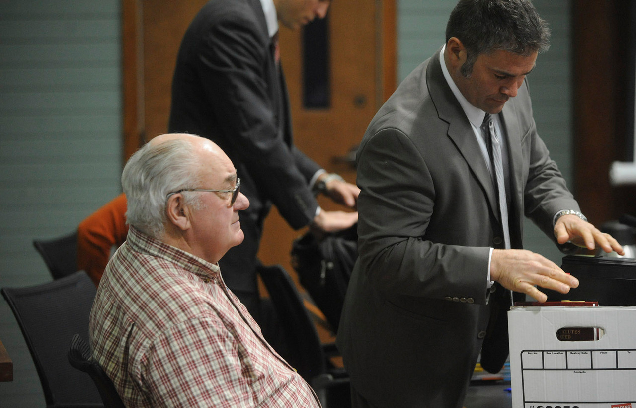 Edwin Vance Bunker (left) waits in the court room on the first day of his trial as his and his daughter Janan Miller's attorneys prepare papers at the the Konx County Superior Court in Rockland Monday.  On the right is Bunker's attorney Philip Cohen. (Bangor Daily News/Gabor Degre)