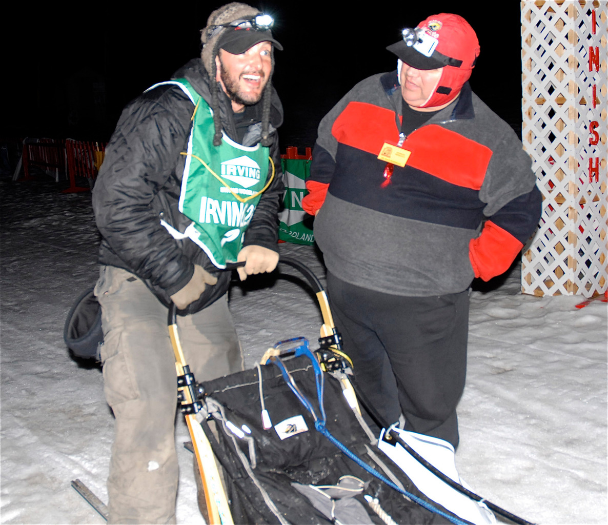 New Hampshire musher Matt Carstens (left) is all smiles after winning his second straight Irving Woodlands Can Am Crown International 250 Sled Dog Race Monday morning, March 8, 2010, in Fort Kent. Carstens crossed the finish line at 3:15 a.m., with a running time of just over 26 hours from his Main Street start on Saturday. (Photo by Julia Bayly)