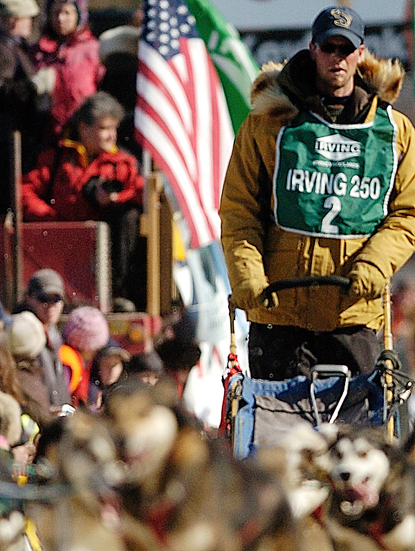 Ryan Anderson of Ray, Minnesota and his dog team make their way down Main Street in Fort Kent during the start of the Can-Am Crown 250 Saturday, March 6, 2010. Arriving in Fort Kent early Monday morning, Anderson finished second with a time of 26 hours,18 minutes,31 seconds. BANGOR DAILY NEWS PHOTO BY JOHN CLARKE RUSS