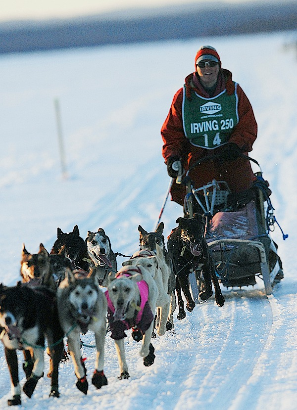 Musher Rita Wehseler of Tofte, Minnesota and her dogs approach the Portage Lake checkpoint in Portage Lake, Maine shortly before sundown Saturday, March 6, 2010. Wehseler went on to take fifth place overall in the Can-Am Crown 250 when she arrived at Fort Kent finish Monday morning, March 8, 2010. BANGOR DAILY NEWS PHOTO BY JOHN CLARKE RUSS