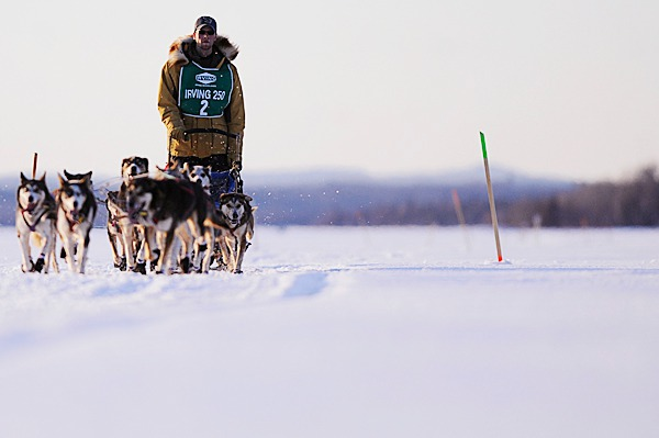 Musher Ryan Anderson of Ray, Minnesota and his dogs approached the Portage Lake checkpoint in Portage Lake, Maine for the Can-Am Crown 250 shortly before sundown Saturday, March 6, 2010. Arriving in Fort Kent early Monday morning, Anderson finished second overall with a time of 26 hours,18 minutes,31 seconds.  BANGOR DAILY NEWS PHOTO BY JOHN CLARKE RUSS