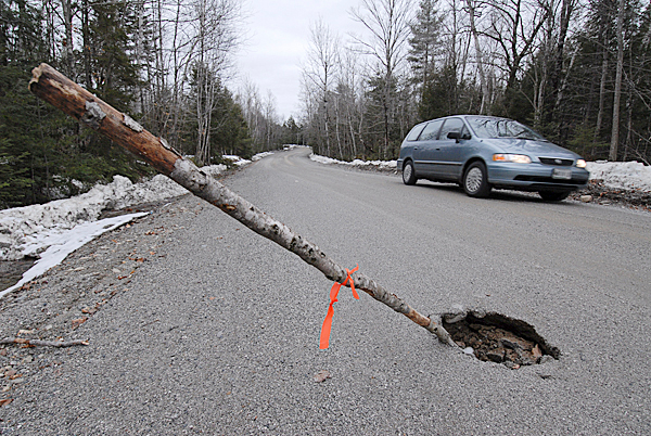 This winter's prolonged thaw and recent rainy weather has created road conditions like this sink hole, approximately 18 inches wide, on this gravel section of Beech Hill Pond Road near the Dedham-Otis town line. Photographed Wednesday afternoon, March 3, 2010. BANGOR DAILY NEWS PHOTO BY JOHN CLARKE RUSS