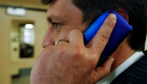 An unidentified man talks on his cell phone outside a hearing  before the Legislature's Health and Human Services Committee concerning cell phone safety, in Augusta, Maine, on Tuesday, March 2, 2010. Supporters of a bill want to require cell phones in Maine to carry warnings that they may cause brain cancer. (AP Photo/Pat Wellenbach)