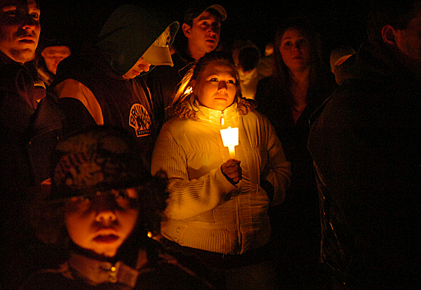 Surrounded by family and friends, Cheryl Metzger (center) listens as people share their thoughts about her son Damien Christopher Lynn during a vigil in his honor at Cascade Park on Tuesday evening, March 9, 2010 in Bangor. BANGOR DAILY NEWS PHOTO BY BRIDGET BROWN