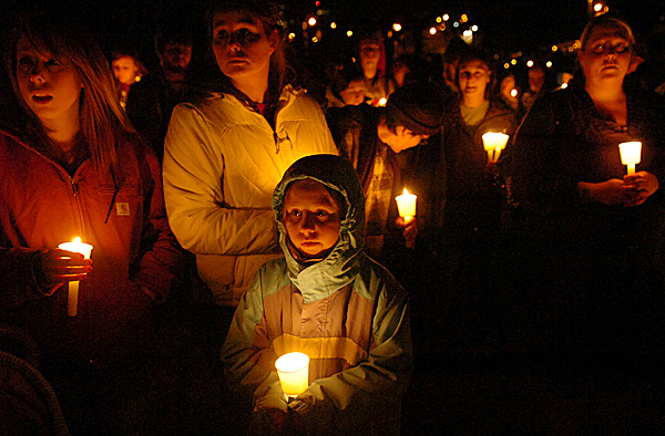 Community members including (from left) Nariah Arey, 17, her mother Bridgette Arey and sister Jenna Arey, 7, of Bucksport participate in a vigil for Damien Christopher Lynn at Cascade Park on Tuesday evening, March 9, 2010 in Bangor. BANGOR DAILY NEWS PHOTO BY BRIDGET BROWN