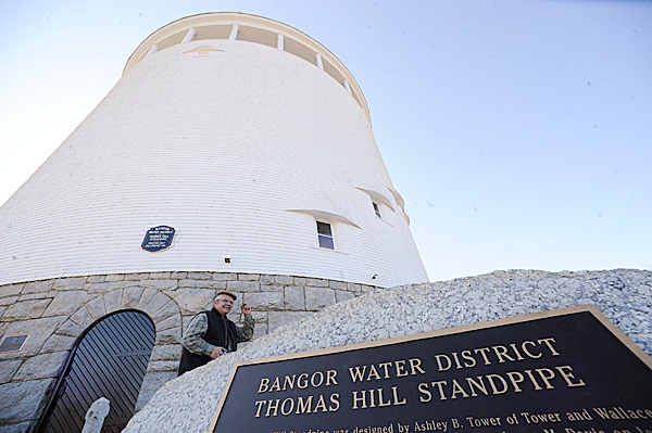 Camera at the ready, Yann Kaloustian (cq) of Hampden walks around the base of the Thomas Hill Standpipe before it opened for tours Wednesday, March 10, 2010. Scores of visitors took advantage of Wednesday's sunny weather to partake in the standpipe's periodic open house. They were treated to panoramic views of Bangor's skyline as well as far off vistas such as snow-capped Mount Katahdin.  BANGOR DAILY NEWS PHOTO BY JOHN CLARKE RUSS