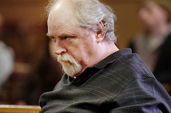 Michael Toby watches as his defense attorney Chris Smith makes his opening statements before Justice William Anderson at Piscataquis County Superior Court in Dover-Foxcroft on Wednesday, March 10, 2010 at the start of Toby's trial for the murder of his older sister, Rosalie Shedd, in October 2008. BANGOR DAILY NEWS PHOTO BY BRIDGET BROWN