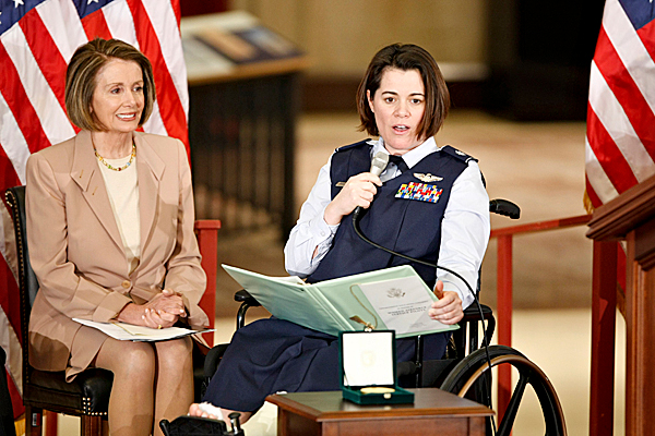 At a ceremony to honor the Women Airforce Service Pilots, or WASPs, Air Force Lt. Col. Nicole Malachowski,right, recounts the contributions of the WASPs as House Speaker Nancy Pelosi of Calif., Wednesday, March 10, 2010, on Capitol Hill in Washington. Malachowski, the first female member of the Air Force Thunderbirds, has been an activist for giving recognition to the WASPs. (AP Photo/J. Scott Applewhite)