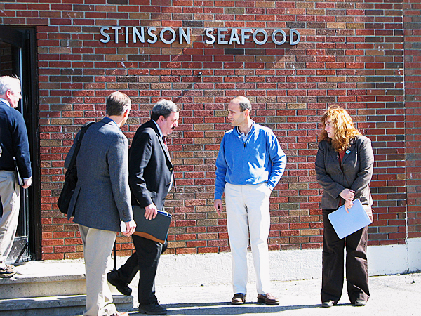 Gov. John Baldacci stands outside the Stinson sardine cannery Prospect Harbor on Friday as members of his staff and cabinet gather around. Baldacci, who met at the plant with Bumble Bee Foods CEO Lischewski, said there are two companies interested in acquiring the plant from Bumble Bee that could employ between 110 and 130 at the plant by July 1.   BANGOR DAILY NEWS PHOTO BY BILL TROTTER