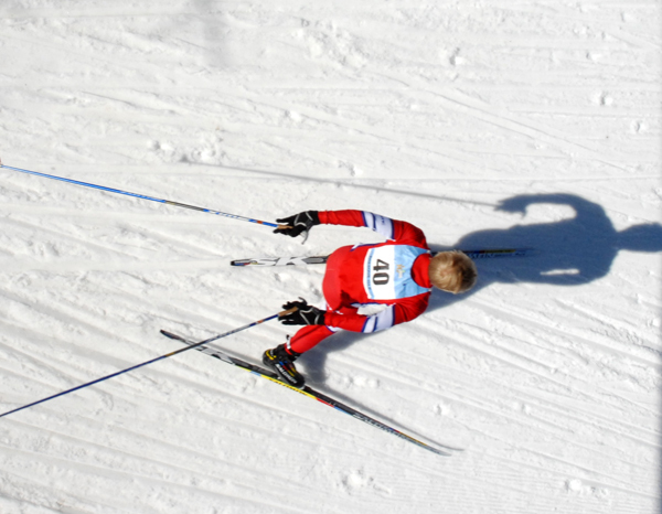 A skier chases his shadow during the freestyle relay at the USSA Junior Olympics in Presque Isle Saturday. Buy Photo
