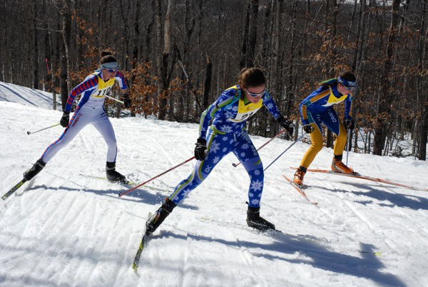 Skiers in the Women's Freestyle Relay battle up one of the climbs during competition at the USSA Junior Olympics in Presque Isle Saturday. Buy Photo